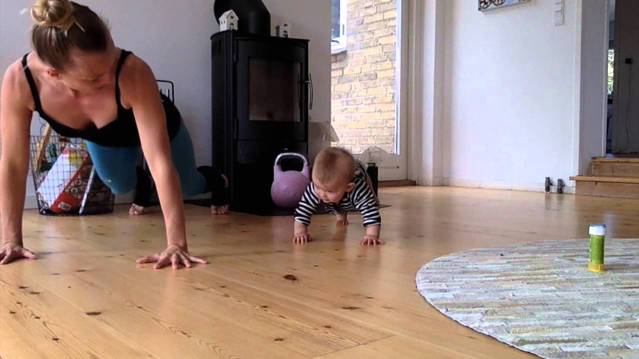 8 month old baby exercising with mom