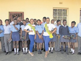 Tiyi and Congi Nkuna with learners at Ndindani High School to whom they donated sanitary towels.
