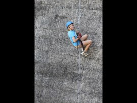 Tanya Nel abseiling down the dam wall.