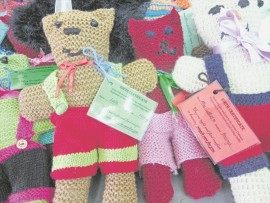 An example of the knitted teddy bears to be distributed to disadvantaged children around the region.