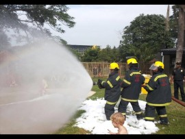 The KwaDukuza Fire Department giving a little foam party for the children at Village Kidz.