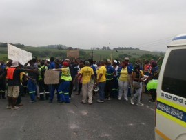 The former employees marching towards the Avon Peaking Power Plant in Shakaskraal.