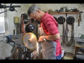 Stefan Diedericks grinds a piece of titanium.