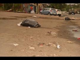 The rubbish strewn parking lot.