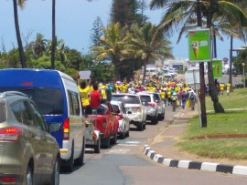 The ANC anti-racism  march making its way along Compensation Beach Road, Ballito.