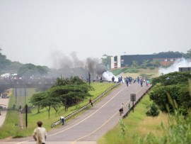 Shaka's Head has often resembled a war zone with volatile protests resuming every few months. Pictured here are protesters on the bridge above the N2 in February this year.