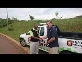 UIP security manager Dieter Fittkau gives UIP guard Ncosana Mkhaliphi an award for helping retrieve a stolen phone and returning it to the owner.