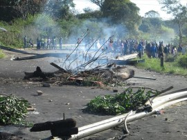 The R102 in Etete has been blocked by angry residents, during their protest for RDP houses in 2013.