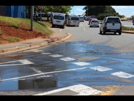 The traffic circle in Ballito with sewage leaking onto it.