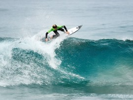 Eli Beukes placing second in Heat 3 of the U16 boys Quarter Finals to advance to the Semi-finals of the Billabong Junior Series Ballito. Photo: Kelly Cestari