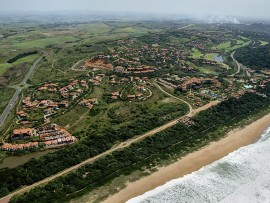 Two armed assailants attacked a Zimbali resident during a reported burglary.
