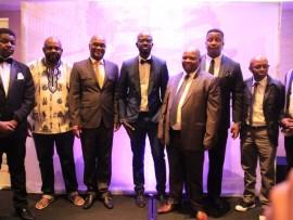 Ricardo Mthembu with, among others, DJ Fresh and home affairs minister, Malusi Gigaba at the Black Coffee BET gala dinner.
