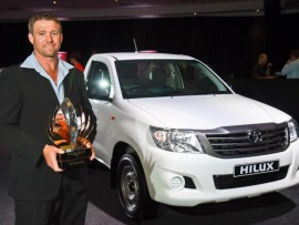 Tongaat's Anthony Goble with the 2015 Agri SA/Toyota Young Farmer of the Year trophy and the Toyota Hilux Single cab bakkie he won.