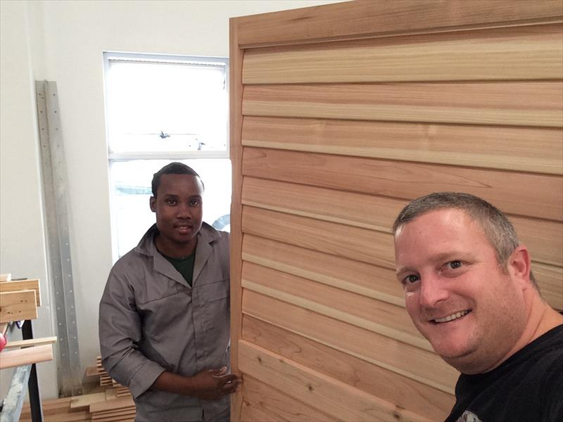 Treasure (Thamsanqa Qwabe) and Grant Wilson showing one of their manufactured shutters.