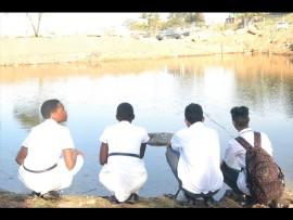 Having fun at their school dam, Emily Nyathi, Abegail Mzimela, Mohammed Humza Bashir and Sahil Kisorlall.