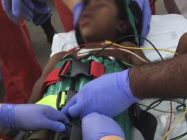Precious Mbovana (6) being treated by paramedics after being shot at Shakaskraal taxi rank this morning.
