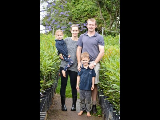 ABOVE: The young Macadamia nut seedling after being planted into a bag.RIGHT: Dustin Cooper and his wife, Charlene with their children, Mackenzie and Matthew enjoying life among Macadamias.