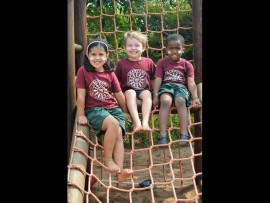 Kyla Sharma, Callum Jay and Philasande Zuma are proud to wear their sunblock during playtime outside.