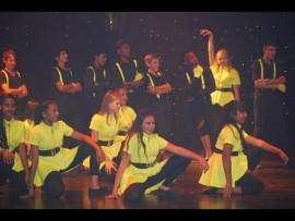 Grade 7 pupils performing with Bantu Bindi (third from the right in the back row).