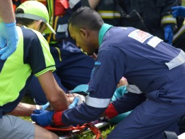 Emergency personnel stabilise a woman after a taxi crash on the R102.