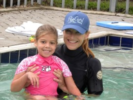 Ashlyn Scharneck with Teacher Anna during  her swimming lesson.