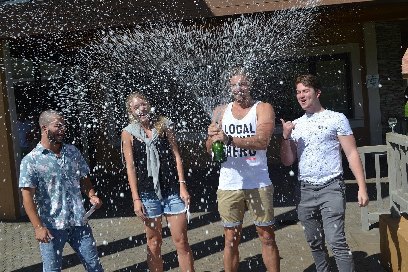 Hard work pays off! Regan Sharp, Danelle van der Linde, Ceagan Scott and Dylan Hugo pop the champagne in celebration of their matric results.