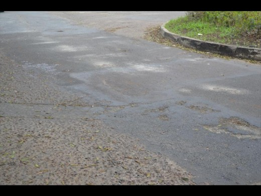 The badly damaged road at the Umhlali circle.