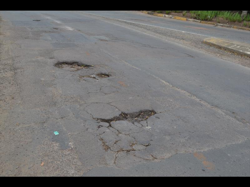 The badly damaged road riddled with potholes at the Umhlali circle.