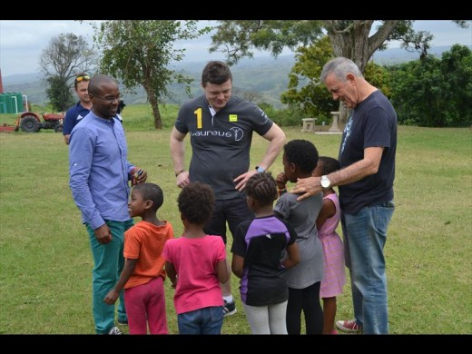 Brian O'Driscoll (centre) is introduced to some of the amazing children at LIV Village by Chester Koyana, LIV's manager and Tich Smith, the founder of LIV Village.
