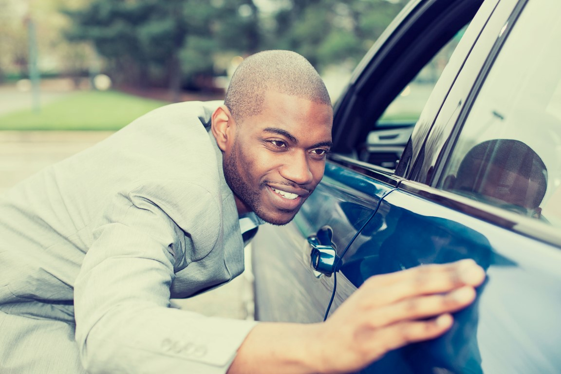 42813850   Excited Young Man And His New Car