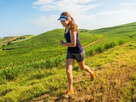 Leading lady, Amy Burger heads through the sugar cane fields on her way to a spectacular finish.
