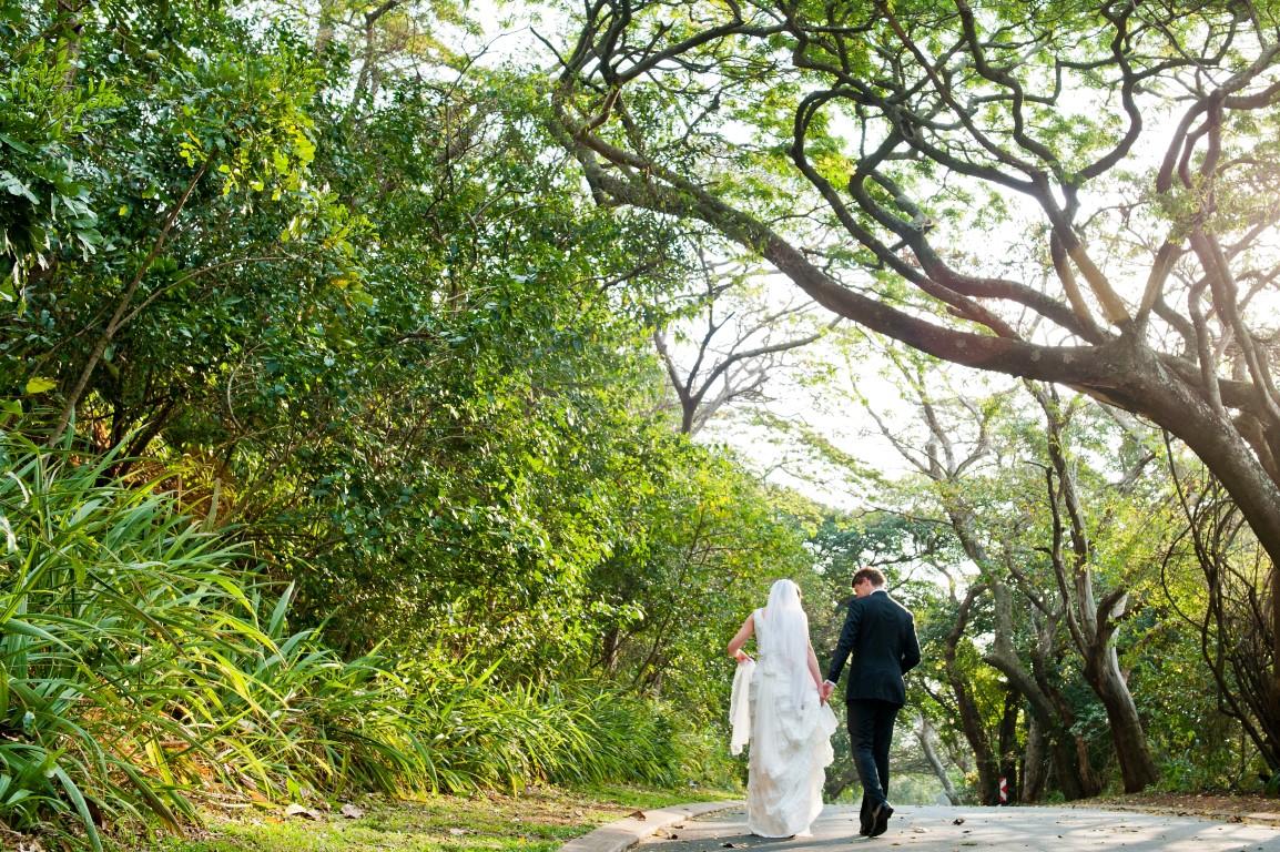 Mr and Mrs Botha walk through the lush bush in Simbithi Estate. Photo: