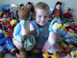 Daniel Meijboom is delighted by the many wonderful toys created by the Thornhill Manor Knitters and sold at last year's fun day.