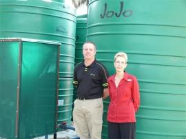 Assistant facilities manager John Switala and Helen Petrie of Ron Smith Care Centre are thrilled about their new JoJo water tank.