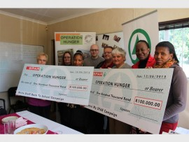 Members of Operation Hunger are ecstatic about the donation from Spar.