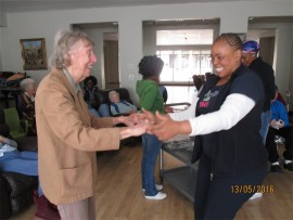 Ron Smith Care Centre resident, Lynne Russell and enrolled nursing auxiliary, Nakedi Chokoe share a dance.