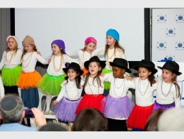 Some of the Torah Academy Pre-Primary School girls entertain the guests at the recent fundraiser at the nursery school.