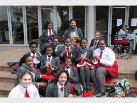 St Mary's girls knit squares as part of Mandela Day.