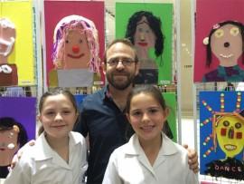Grade 3 pupil, Aviva Samuals with Hanoch Piven, a world-famous Israeli illustrator, and Hannah Gordon at the annual art exhibition.