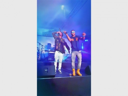 Yung Swiss performs with Reason live on stage.