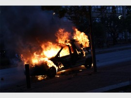 A Parkview police van set alight in Braamfontein on 25 October.