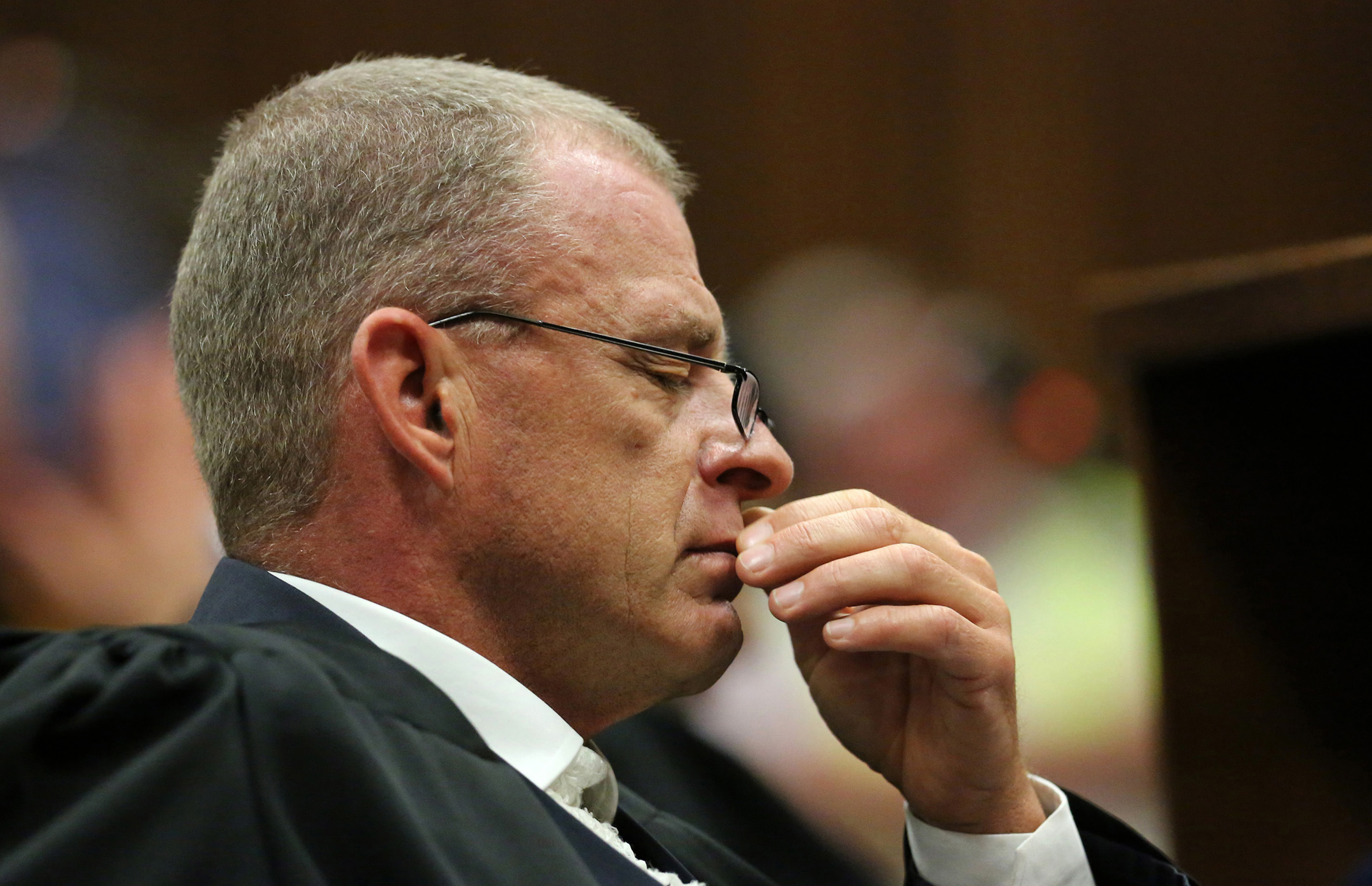 Prosecutor Gerrie Nel reacts as judgment is handed down in the murder trial of paralympic track star Oscar Pistorius at the High Court in Pretoria on Friday ... - Gerrie-Nel