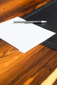 Pen and paper on a desk