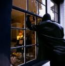 Burglar Smashing Through Window