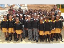 Excited pupils of Mveledzo Primary School with their new school uniforms.