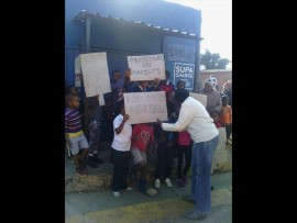 Locals protesting against the crime. Photos: Supplied.