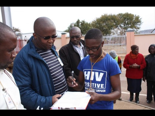 David Skosana, Chairperson of Treatment Action Campaign handing over a memorandum to Dr Lesego Pooe of Mamelodi hospital.
