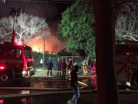 Firefighters attempted the put out the blaze that consumed the house. Photo: Supplied.