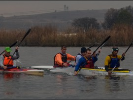 All the podium placed canoeist of last week's Centurion 9 Miler canoe race at Rietvlei dam together. From left are Luke Symons with James Goddard (first place finishers), second place finishers Phineas Zulu with Alex Roberts (in front of the pack  on this photo) and third place podium finishers on far side, Gustav Radloff with Wally Fisher. Photo: Jenny Dallas