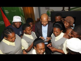 Tshwane mayor Kgosientso Ramokgopa (in jacket) said the metro heeded the calls by students and pupils to increase the daily data limit to 500MB per device, per day. Photo: Supplied